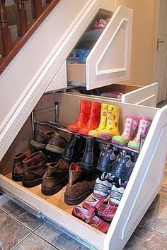 Great under stair storage solutions - this one for hiding away muddy boots is great!