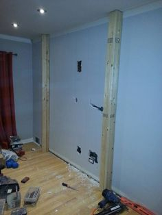 Here's the start of the project - a blank wall, a couple holes, and a wooden frame.