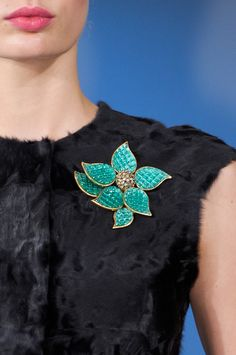Oscar de la Renta at New York Fashion Week adds the perfect pop of color with this flower brooch.
