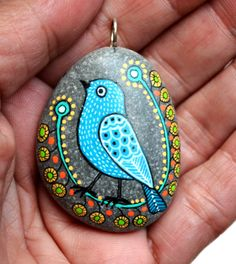 Hand Painted Pebble Bird Pendant /      These pendants are unique with their design. I paint and draw all of my original designs by hand with the acrylic paints, small brushes or paint pens with extra fine tip. I use also isographs (0,2 / 0,3) with different inks. No stencils are used. All designs are created with my imagination. They are protected with 2 or 3 layers of high quality acrylic varnish coat and are signed & numbered . For pendants its not recommended wearing them in the shower…