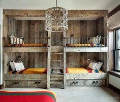 Rustic country bunk room features built-in barnwood bunk beds dressed in yellow bedding flanking a rustic bunk bed ladder illuminated by a wood geometric drum pendant. (Cool Rooms With Bunk Beds) Bunk Bed Ladder, Bunk Beds Built In, Bunk Beds With Stairs, Cool Bunk Beds, Kids Bunk Beds, Build In Bunk Beds, Bunk Beds With Storage, Amazing Bunk Beds, Lofted Beds