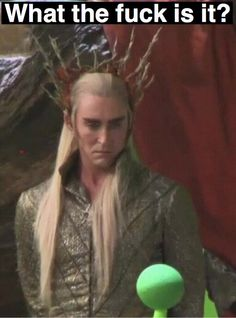 The look says it all..thranduil is not amoosed by this green ball of socery.