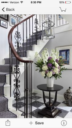 Navy stair runner with silver rods.