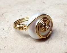 White Freshwater Pearl Ring:  Classic Wedding Jewelry, Brass Swirl Wire Wrapped Ring, Size 7, Custom Size. $28.00, via Etsy.