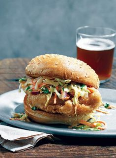 Beer-Battered Fried Chicken Sandwich Recipe (With its ethereally crisp coating and its sassy slaw, this fried chicken sandwich just may be chickens answer to the pulled pork sandwich. Chicken Sandwich Recipes, Fried Chicken Sandwich, Pork Sandwich, Soup And Sandwich, Burger Recipes, Dog Recipes, Beer Battered Chicken, Sandwich Croque Monsieur, Dessert