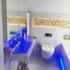 This funky #bathroom has fab neon lights and colourful #mosaic tiling. #bathroominterior #bathroomdesign #instahome #instadesign #roomsforinspo #inspiration #instastyle #bathroomdecor #tiling #mosaictile #bathroominspo #bathroomremodel #bathroomideas #bathroominspiration by refurbital Bathroom designs.