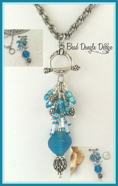Beautiful Turquoise Sea Glass accented with Glass Bugle Beads, Swarovski Crystals and Pewter Accent Beads. Beaded Dangles are Interchangeable so you can replace with a variety of Dangles available. Visit Bead Dangle Design to see entire Collection.