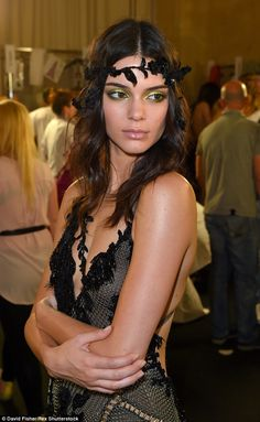 Pretty: The low-cut garment retained Kendall's modesty thanks to crossover embellishment...