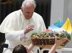 Pope blesses flowers as he leaves general audience in St. Peter's Square at Vatican