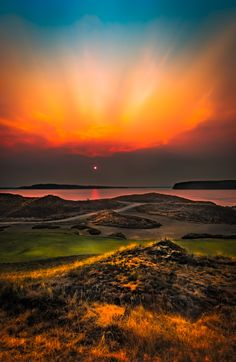 Chambers Bay Sunset - Nearby forest fires produced this smokey sunset.