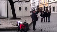 HeSings On A Street Corner, But Keep An Eye On The Baby In The Stroller…