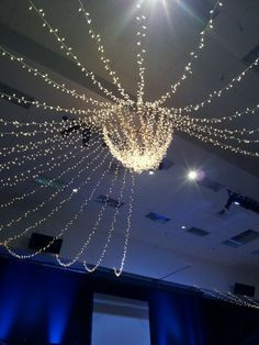 Homemade chandelier for a special night or wedding. Can use wire, piping, or steel for one round center piece. Attatch power strips together in an x at center. Drape Christmas lights of chosen color. Doing this!