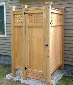 A few extra feet of fencing and a water source was all it took to create this casual outdoor shower