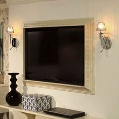 Crown molding around your flat screen TV, now that is a good idea!!