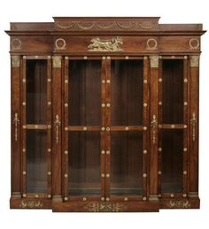 An Empire style gilt bronze mounted bibliothèque  height 84 1/2in; width 83in; depth 16in