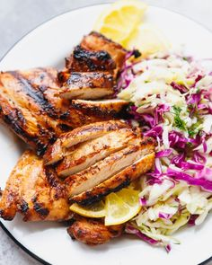 Easy Grilled Chicken Thighs - juicy marinated boneless skinless chicken thighs, grilled to perfection and served with a salad, slaw or vegetables. Perfect to add to grain or grain-free bowls and salads.