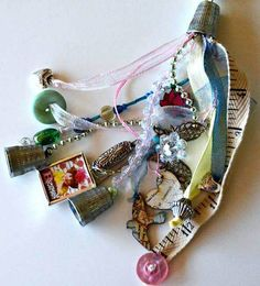 Mixed-media tassel. With an awl, poke a hole through a thimble. Then string on ribbons, beads, buttons, and charms. Happiness!