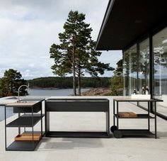 A modern outdoor kitchen & charcoal grill by Swedish designers Johan Ridderstrale & Mat Broberg for Roshults.First seen here: http:/...