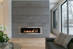 Floor to ceiling lightweight concrete panels by DEKKO Concrete. Beautiful grey stone surrounds the gas fireplace. love this background with linear fireplace, just would add mantel. Log Burner Fireplace, Linear Fireplace, Fireplace Seating, Shiplap Fireplace, Small Fireplace, Concrete Fireplace, Fireplace Hearth, Home Fireplace, Fireplace Remodel