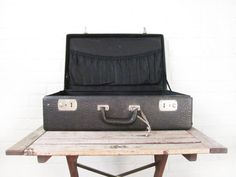 This gorgeous antique black leather (leatherette? it may be a convincing faux leather) suitcase is the perfect accessory for your vintage display,