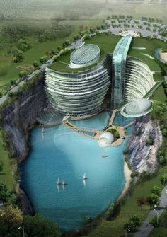 Songjiang Hotel Shanghai... NestleS into the 100 metre-high rockface of an abandoned water-filled quarry outside Shanghai.  A huge waterfall will pour down from the roof of the 19-storey hotel complex, which will have part built into the cave and two floors submerged. An extreme-sports facility in the quarry will include rock climbing and bungee jumping, and there will also be an underwater restaurant facing a ten-metre deep aquarium.