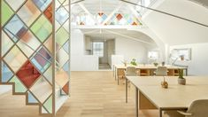 Stained glass dividers define London co-working space inside church Chapel Conversion, Church Conversions, Medieval Stained Glass, Stained Glass Church, Coworking Space, Sofa Design, Glass Office, Church Interior, Interior Office