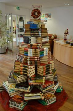 We love this DIY book Christmas tree made from stacked hardcovers of varying widths and thickness. This article has 19 more bookish Christmas tree ideas! Book Christmas Tree, Creative Christmas Trees, Book Tree, Holiday Tree, Christmas Holidays, Christmas Crafts, Holiday Decor, Christmas Ideas, Xmas Trees