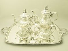 An exceptional, fine and impressive vintage Elizabeth II English sterling silver five piece tea and coffee service in the Louis style; an addition to our teaware collection