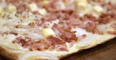 Flammekuche (Tarte flambée) is a--includes Munster Cheese. Toppings (onions and lardons) go on top of cream/cheese mixture
