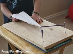 Build an airplane launcher!  http://frugalfun4boys.com/2014/01/30/paper-airplane-launcher/