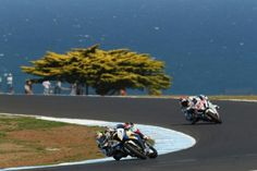 Leon Camier- Cresent Fixi Suzuki chases Chaz Davies- Goldbet BMW at Phillip Island during first competition of 2013
