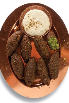 Saveur Magazine Falafel:  There is nothing like falafel's first bite: the crisp-fried exterior giving way to a creamy center of seasoned mashed beans, garlic, and parsley.