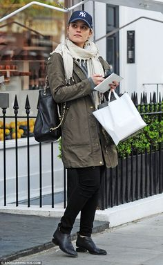 Au naturel: Dianna Agron stepped out in London on Tuesday, wearing several layers... apart...