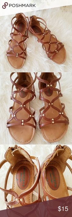 Zip Up Strap Sandals Brown zip up strap sandals in great used condition. This sandals are so cute with jeans and pair easily with a skirt too! Zip up back and adorable strap top. Shoes Sandals