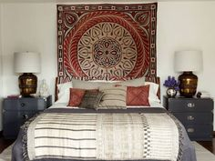 Ellen Pompeo's house. I could pin the whole thing. An early 20th century Egyptian tapestry on the wall behind the bed, the antique Moroccan embroidered pillows are from Pat McGann in Los Angeles and the rug is vintage Afghani.