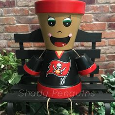 Excited to share this item from my shop: Tampa Bay Buccaneers Flower Pot People / football decor/ clay pot people/ Raiders Clay Pot Projects, Clay Pot Crafts, Diy Crafts, Diy Clay, Flower Pot People, Clay Pot People, Clay Flower Pots, Clay Pots, Football Crafts