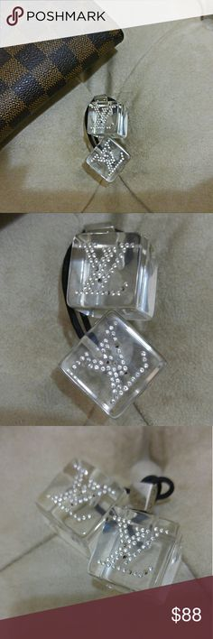 Authentic Louis Vuitton Swarovski Hair Cubes They are missing a few stones on each as shown in the photos but it doesn't take away from their beauty or sparkle at all. Elastic is perfect and tight. Guaranteed authentic. Listing is for the hair cubes only. Price is firm. Louis Vuitton Accessories