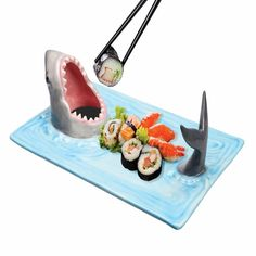Sharks love sushi and so do you. Share the love by putting a little soy sauce and wasabi in the shark's mouth and give the shark a taste before you remind him that you're the top of this food chain.