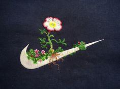 Des broderies champêtres sur des logos de vêtements de sport