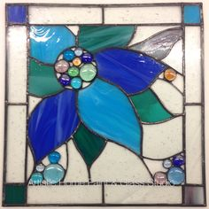 Stained glass panel created by one of our students.