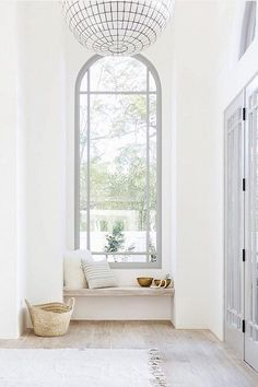 I love a window seat tucked in to a cozy nook. Piled with a thick cushion, a few pillows, and a beautiful throw it creates a welcoming warmth and instant character. A window seat is not only pretty, b Casa Milano, White Oak Floors, White Walls, Gray Walls, Entry Way Design, Foyer Design, Lobby Design, Interior Modern, Simple Interior