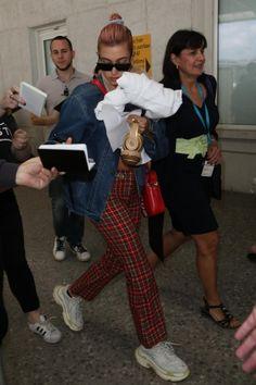 Hailey Baldwin wearing Miaou Morgan Plaid Trousers, Balenciaga Triple S Sneakers, Supreme X Louis Vuitton Danube Shoulder Bag, Beats Studio3 Over the Ear Wireless Headphones and Vera Wang Hesse Sunglasses