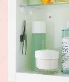 Attach Tweezers to the Inside of a Bathroom Cabinet with a Magnet | 52 Totally Feasible Ways To Organize Your Entire Home