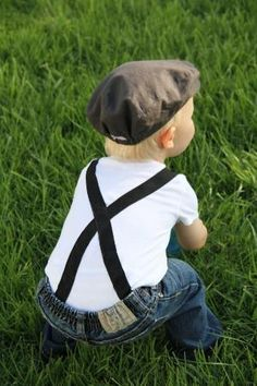 Jeans, suspenders and a newsboy hat
