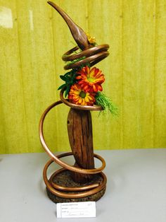 New Garden Club Journal   Sculptural floral design   using copper tubing       flower arrangement