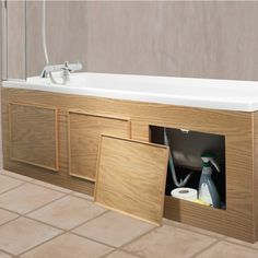 This just makes so much sense to have access to under the tub. Ours is a solid plywood panel.