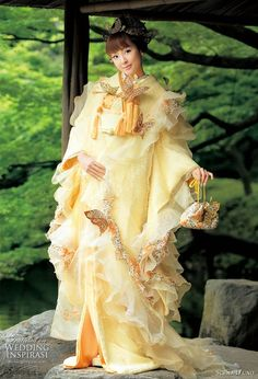 Modern-style wedding kimono from Scena D'uno...yellow with leopard-print trim and butterflies