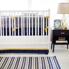 Navy and Gold Arrow Crib Bedding is a must have for your baby boy's nursery! Our Go Your Own Way Baby Bedding Collection is adventurous and fun!