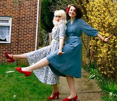 The bright young twins. Loving the red shoes and blue dress combination.