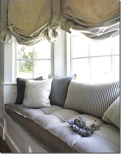 Oh I want to do this to my bay window minus the window treatment.